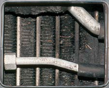 Odors, bacteria, mold, spores, fungi, road grime, nicotine oils and debris accumulate in your car's air conditioning evaporator